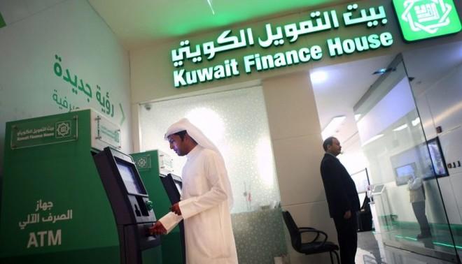 بيت التمويل الكويتي يستحوذ على البنك الأهلي المتحد البحريني